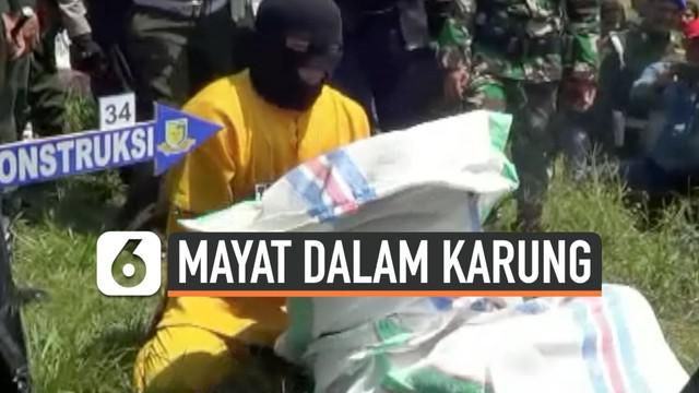 Rekonstruksi kasus pembunuhan digelar di Polewali Mandar Sulawesi Barat. Terduga pembunah peragakan lebih dari 60 adegan, saat menghabisi nyawa istrinya dan membuangnya ke saluran irigasi.
