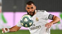 6. Karim Benzema - Karim Benzema tampil brilian dan menjadi andalan lini depan Real Madrid pada musim ini. Pemain asal Prancis telah mencetak 21 gol dan delapan assist di La Liga. (AFP/Gabriel Bouys)