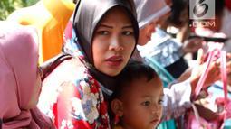 Anak balita bersama ibunya di Puskesmas, Kaduhejo, Pandeglang (14/9). Kondisi gagal tumbuh kronis yang irreversible, tanpa pengetahuan orang tua, tenaga kesehatan, serta fasilitas dan ketersediaan pangan yang memadai. (Foto:Istimewa)