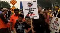 Warga Malaysia gelar unjuk rasa terkait kekerasan militer Israel, hingga bocah di India sangat mahir mengemudikan traktor.