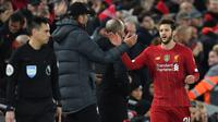 Manajer Liverpool, Jurgen Klopp, memastikan Adam Lallana akan meninggalkan klub musim ini seiring berakhirnya kontrak di Anfield Stadium. (AFP/Paul Ellis)