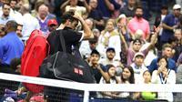 Unggulan tiga AS Terbuka 2019 Roger Federer dikalahkan Grigor Dimitrov pada perempat final, Selasa (3/9/2019) atau Rabu WIB. (AFP/Al Bello)