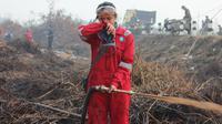 Intan saat bertugas memadamkan api di lahan gambut Kabupaten Pulang Pisau, Kalteng. (Ist)