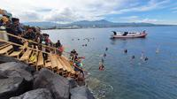 Upaya melindungi, melestarikan dan memanfaatkan sumber daya terumbu karang di Taman Nasional Bunaken secara berkelanjutan.