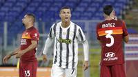 Ekspresi bintang Juventus. Cristiano Ronaldo, setelah menjebol jala AS Roma pada lanjutan Liga Italia di Stadion Olimpico, Senin (28/9/2020) dini hari WIB. (AP/Gregorio Borgia)