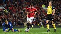 Pemain Manchester United, Anthony Martial merayakan golnya ke gawang Basel pada babak ketiga Piala Liga Inggris di Old Trafford stadium, Manchester, (12/9/2017).  MU menang 4-1.  (AFP/Paul Ellis)
