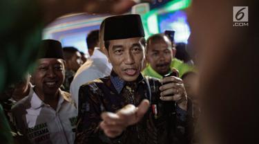 Presiden Joko WIdodo tiba menghadiri Harlah ke-46 PPP di kawasan Ancol, Jakarta, Kamis (28/2). harlah ke-46 PPP mengusung tema 'Membangun Keluarga Membangun Bangsa'. (Liputan6.com/Faizal Fanani)