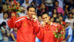 Pasangan ganda putra, Hendra Setiawan dan Markis Kido menyumbangkan medali emas untuk Indonesia pada Olimpiade Beijing tahun 2008 silam. Mereka berdua mampu takhlukkan pasangan tuan rumah, Cai Yun dan Fu Haifeng di partai puncak. (Foto: AFP/Goh Chai Hin)
