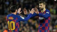 Lionel Messi dan Gerard Pique. (AFP/Lluis Gene)