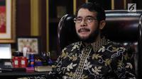 Ketua Mahkamah Konstitusi terpilih yang baru saja menjabat Anwar Usman saat melakukan foto sesi dan wawancara khusus dengan tim Liputan6.com. (Liputan6.com/Johan Tallo)