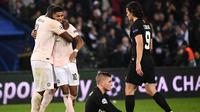 Manchester United berhasil lolos ke perempat final Liga Champions berkat keunggulan gol tandang dalam agregat 3-3. Pada pertandingan leg kedua di Parc des Princes, Rabu (6/3/2019), MU menang 3-1 atas PSG. (AFP/FRANCK FIFE)