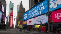 Layar menunjukkan ucapan terima kasih terhadap petugas kesehatan terlihat di Times Square, New York, AS, Senin (27/4/2020). Menurut Center for Systems Science and Engineering di Universitas Johns Hopkins hingga 29 April 2020 WIB, jumlah kasus COVID-19 di AS melampaui 1 juta. (Xinhua/Michael Nagle)