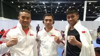 Atlet wushu Indonesia yang akan berlaga pada final Sanda putra SEA Games 2019, yaitu Laksamana Pandu, Ade Permana dan Yusuf Widiyanto. (dok. KONI)