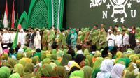 Presiden Jokowi menghadiri Harlah ke-73 Muslimat NU di GBK, Jakarta. (Liputan6.com/Putu Merta Surya Putra)