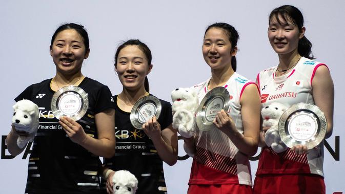 Ganda putri Jepang, Mayu Matsumoto/Wakana Nagahara yang berhasil mengalahkan wakil Korea, Kim Hye-jeong/Kong Hee-yong dengan skor 21-17, 22-20 di final Singapura Terbuka 2019. (AFP/