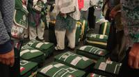 Jemaah haji Indonesia sedang mencari koper miliknya. Darmawan/MCH