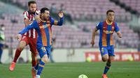Megabintang Barcelona, Lionel Messi, gagal membawa timnya meraih kemenangan saat bersua Atletico Madrid pada laga pekan ke-35 La Liga di Camp Nou, Sabtu (8/5/2021) malam WIB. Barca harus puas bermain 0-0 kontra Atletico. (AFP/Josep Lago).
