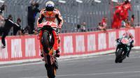 Pembalap Repsol Honda, Marc Marque, berhasil meraih podium juara MotoGP Jepang yang berlangsung di Sirkuit Twin Ring Motegi, Minggu (20/10/2019) siang WIB. (AFP/Toshifumi Kitamura)