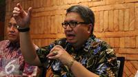 Ketua Aprindo Roy Mandey menjelaskan kepada awak media di Jakarta, Senin (3/10). Dengan Permen tersebut, maka masyarakat lebih terikat. Meskipun ada penolakan, program kantong plastik berbayar akan tetap dijalankan pemerintah. (Liputan6.com/Angga Yuniar)