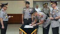 Kapolri Jenderal Tito Karnavian memimpin sertijab, Jumat (13/9/2019). (Merdeka.com/Nur Habibie)