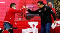 Sekjen PDIP Hasto Kristiyanto dan Ketua DPP PDIP bidang Pemuda dan Olah Raga, Eriko Sotarduga dalam sebuah acara. (Liputan6.com/Putu Merta Surya Putra)