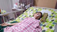 Sutini TKI Singapura yang terancam angkat kaki dari RS lantaran tak dapat membayar biaya pengobatan. (Liputan6.com/FMN Purwokerto/Muhamad Ridlo)
