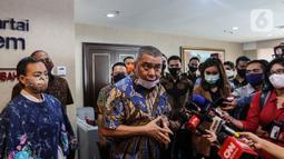 Wakil Ketua Umum DPP Partai NasDem Ahmad Ali dan Calon Wakil Walikota Tangsel dari Partai Gerindra Rahayu Saraswati Djojohadikusumo memberikan keterangan kepada awak media di Kompleks Parlemen Senayan, Jakarta. Rabu (29/7/2020). (Liputan6.com/Johan Tallo)