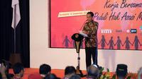Presiden Jokowi memberikan sambutan saat peringatan ke-69 Hari HAM Sedunia di Solo, Jawa Tengah, Minggu (10/12/2017). (Liputan6.com/Fajar Abrori)