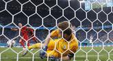 Kemenangan Belgia di pertandingan melawan Finlandia, membawa mereka keluar menjadi juara Grup B yang akan melenggang ke babak 16 besar setelah mengoleksi poin penuh putaran pertamanya.  (Foto: AP/Pool/Dmitri Lovetsky)