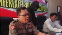 Pemuda pelaku ujaran kebencian, yang diketahui  berinisial IB, warga kelurahan Dulalowo, Kota Gorontalo itu kini mendekam di tahanan Polda Gorontalo. (Liputan6.com/Andri Arnold)