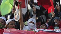 Peserta aksi massa Gerakan Nasional Kedaulatan Rakyat saat melakukan unjuk rasa di perempatan dekat Gedung Bawaslu, Jakarta, Rabu (22/5). Dalam aksinya, mereka meminta Bawaslu memeriksa kembali hasil Pemilu 2019. (Liputan6.com/Helmi Fithriansyah)