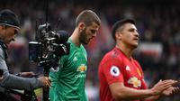 Kiper Manchester United, David de Gea, setelah laga melawan Chelsea dalam lanjutan Premier League di Old Trafford, Minggu malam WIB (28/4/2019). (AFP/Paul Ellis)