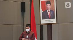 Direktur Utama BPJamsostek Anggoro Eko Cahyo memberi sambutan pada peresmian kanal pembayaran iuran BPJamsostek untuk Pekerja Migran Indonesia (PMI) Malaysia di Jakarta, Kamis (27/5/2021). (Liputan6.com/Fery Pradolo)