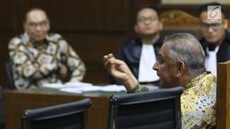 Dirut PT PLN (Persero), Sofyan Basir saat memberikan kesaksian untuk terdakwa kasus suap pembangunan PLTU Riau-1, Johannes Budisutrisno Kotjo pada sidang lanjutan di Pengadilan Tipikor, Jakarta, Kamis (25/10). (Liputan6.com/Helmi Fithriansyah)