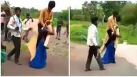 Dituduh selingkuh, wanita ini dihukum dengan gendong suaminya. (Sumber: Twitter/@Nims_Ahuja)