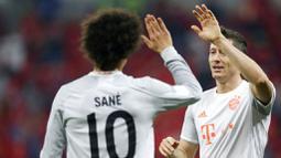 Robert Lewandowski menjadi bintang kemenangan Bayern Munchen dengan memborong dua gol. (AP Photo/Hussein Sayed)