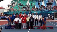 Christopher Rungkat/Aldila Sutjiadi merebut medali emas ganda campuran tenis Asian Games 2018. (Liputan6.com/Luthfie Febrianto)
