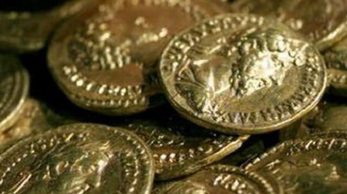 Ilustrasi koin emas (AP)