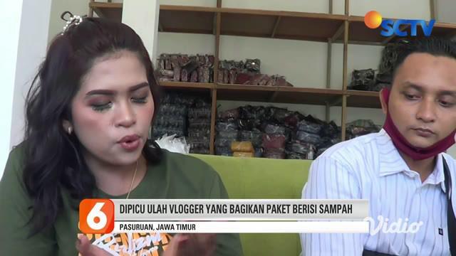 Suami istri naik mobil mewah bagikan nasi bungkus berisi uang jutaan rupiah kepada warga miskin di Pasuruan, Jawa Timur. Video aksi suami istri itu beredar viral di media sosial dan grup WhatsApp. Belakangan terungkap pasangan suami istri itu asal Ge...