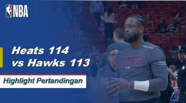 Dwyane Wade mengucurkan 23 poin saat Heat menahan Hawks untuk mendapatkan kemenangan 114-113.