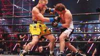 Youtuber Jake Paul menang KO saat bertarung melawan Ben Askren di di Mercedes-Benz Stadium, Atlanta, Georgia, 17  April 2021  (Al Bello/ AFP)