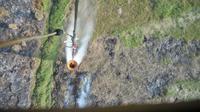 Pemadaman kebakaran hutan dan lahan (karhutla) di Sumsel menggunakan helikopter (Liputan6.com / Nefri Inge)