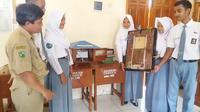 Alat peringatan dini longsor canggih berbiaya terjangkau karya guru fisika di SMK N 2 Bawang, Banjarnegara. (Foto: Liputan6.com/Muhamad Ridlo)
