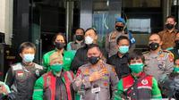 Pengemudi ojek online dari Grab Indonesia mendatangi Polda Metro Jaya. (istimewa)