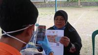 Kemensos menggandeng PT Pos Indonesia untuk menyalurkan Bantuan Sosial Tunai (BST) kepada )warga terdampak pandemi covid-19. (Istimewa)