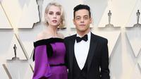 Lucy Boynton dan Rami Malek hadiri Oscar 2019 di Hollywood, California, Amerika Serikat, 24 Februari 2019. (FRAZER HARRISON / GETTY IMAGES NORTH AMERICA / AFP)