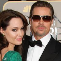 Amber Heard berhubungan dengan Johnny Depp karena film Rum Diary. Mereka berhubungan saat Johnny masih berkomitmen dengan ibu dari kedua anaknya, Vanessa Paradis. (Valerie Macon/AFP)