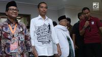 Pasangan Capres-cawapres, Joko Widodo dan Ma'ruf Amin tiba di gedung KPU untuk melakukan pendaftaran di Jakarta, Jumat (10/8). Pasangan Jokowi-Ma'ruf Amin mendaftarkan diri sebagai capres-cawapres di Pilpres 2019. (Liputan6.com/Helmi Fithriansyah)