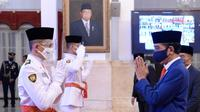Wakil Kalimantan Selatan, Muhammad Asri Maulana usai dikukuhkan sebagai Paskibraka 2020 oleh Presiden Joko Widodo (Jokowi) di Istana Negara pada Kamis, 13 Agustus 2020 (Foto: Dokumen Istana)