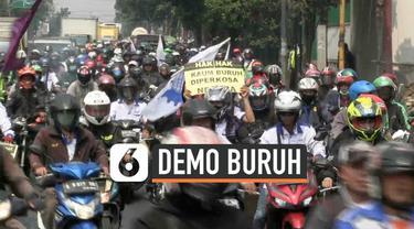 Ribuan buruh Kota Tangerang berkonvoi ke Jakarta bergabung dengan rekan-rekan mereka berdemo ke Jakarta. Personel TNI dan Polri mengamankan sejumlah Tituk yang dilalui oleh konvoi buruh.